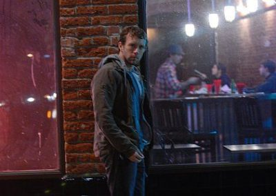 Image of TJ Thyne standing outside of a bar from his TJ in his city Los Angeles photoshoot