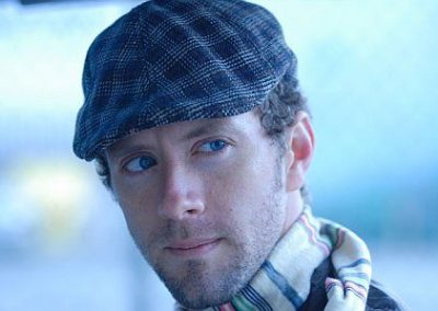 Image of TJ Thyne wearing a cap from his TJ in the City Los Angeles photoshoot