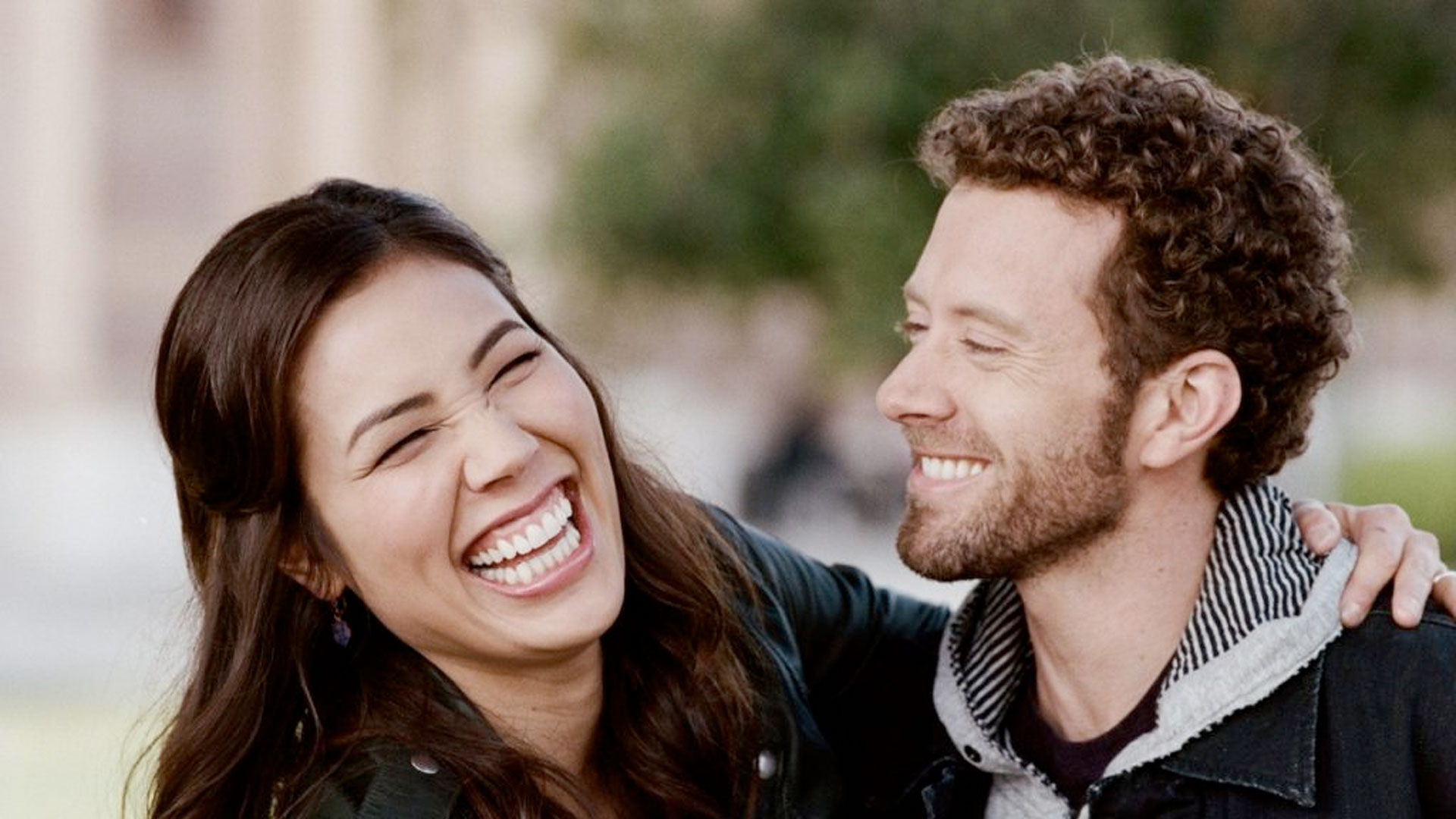 Michaela Conllin and TJ Thyne, laughing together