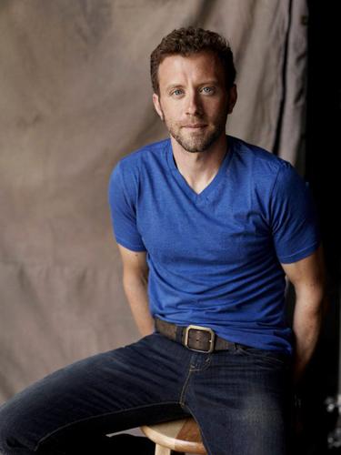 TJ-Thyne-Blue-t-shirt-indoors-seated-photo21