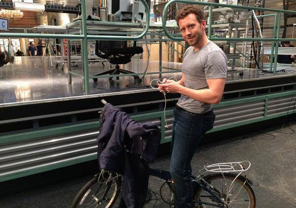 TJ Thyne on a bicycle, on the Bones set
